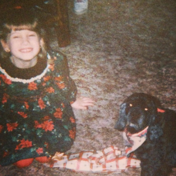 That's me on that Christmas cheesin' in a poinsettia dress with my aunt's dog Princess