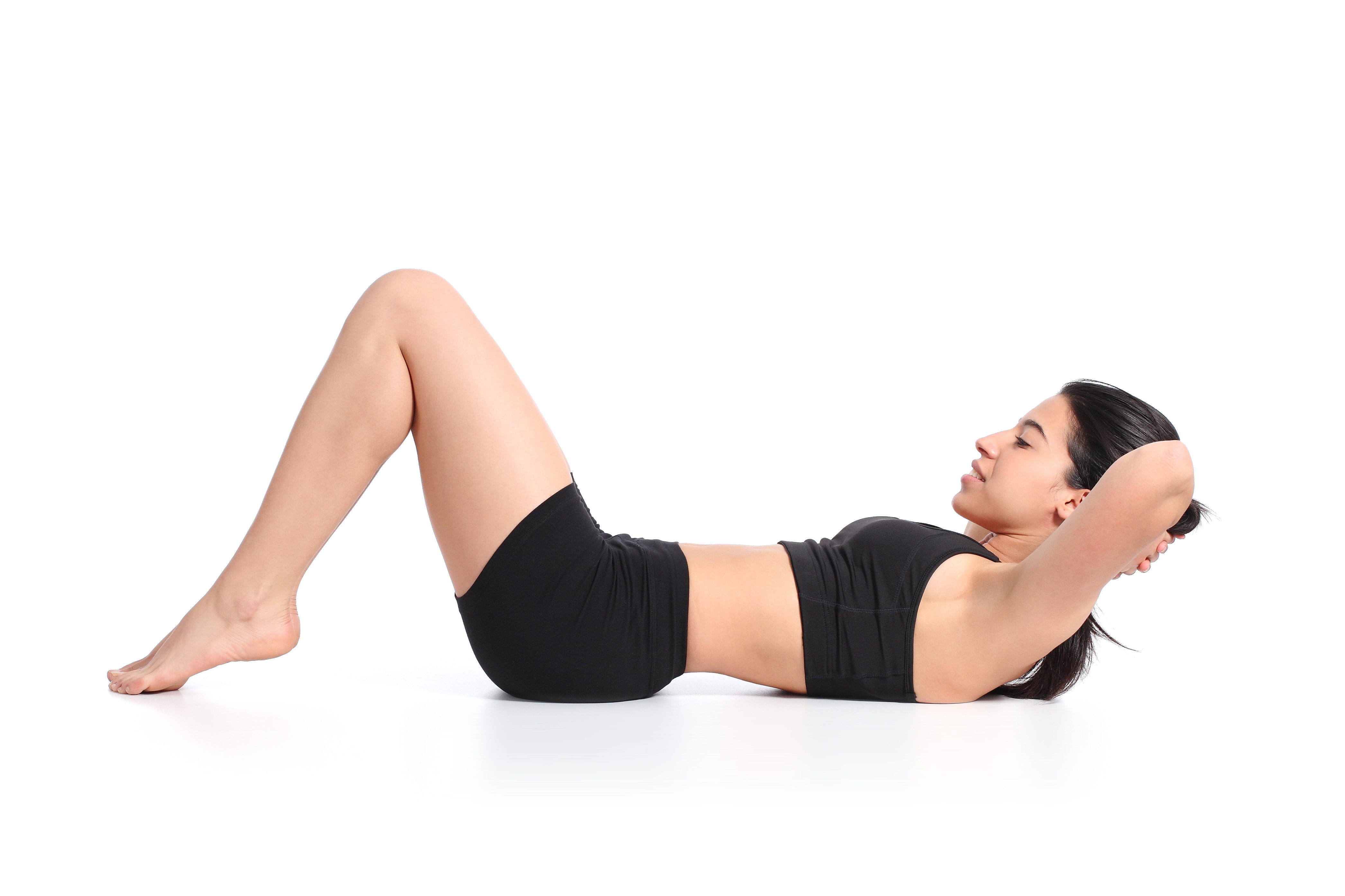 Fitness woman lying doing crunches barefoot isolated on a white background