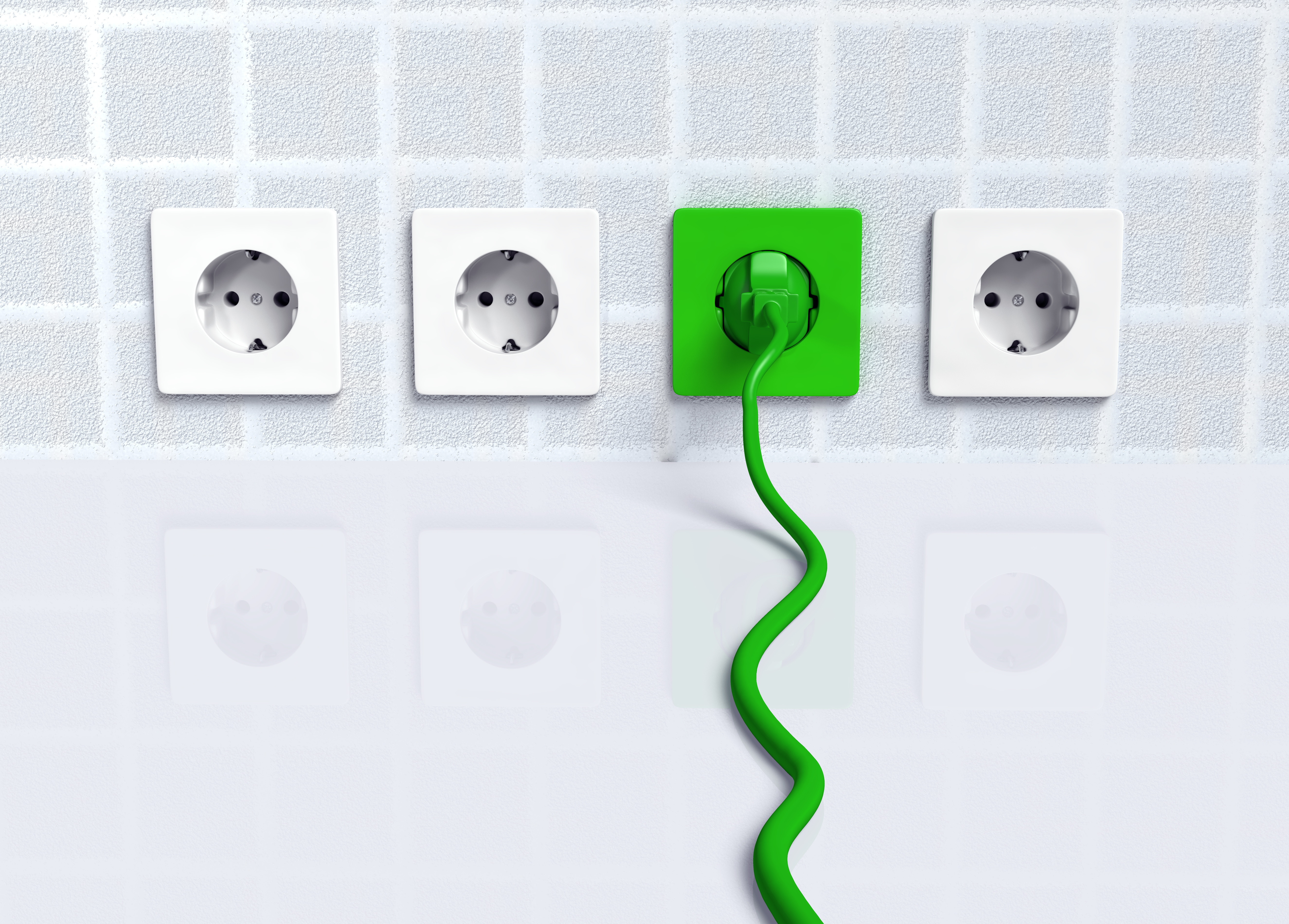 ecological green plug is connected to a green socket placed on the wall instead of the white ones