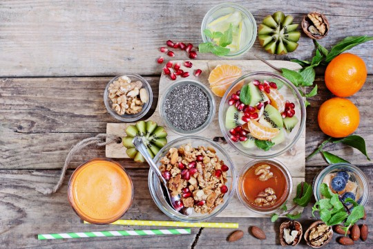 Breakfast set with granola, fruits salad, fresh juice and various of topping. Anti-inflammatory