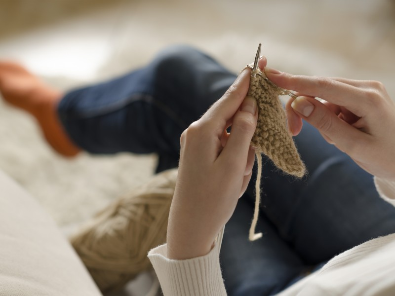 Hands of a young woman knitting. Closeup