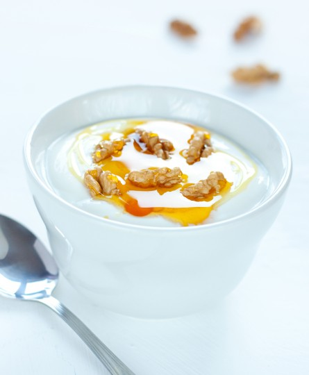 Yogurt with walnuts and gold honey - traditional greek dessert
